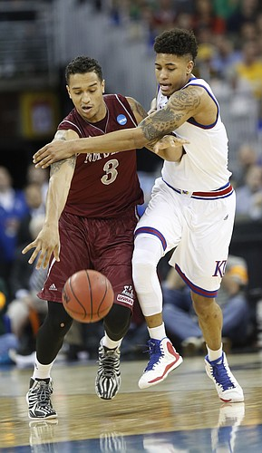 Kansas guard Kelly Oubre, Jr. (12) puts pressure on New Mexico State forward Remi Barry (3) in the Jayhawks win over New Mexico State Friday, March 20, 2015 at the CenturyLink Center, Omaha, NE.