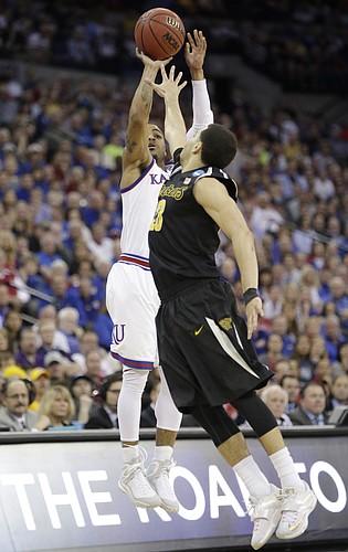 Kansas guard Frank Mason III (0) shoots over Wichita State guard Fred VanVleet (23) in the Jayhawks' third-round NCAA Tournament game against Wichita State Sunday, March 22, 2015 at the CenturyLink Center, Omaha, Neb.