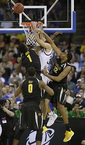 Kansas forward Perry Ellis is fouled on a dunk attempt  in the Jayhawks' 78-65 loss to Wichita State Sunday, March 22, 2015 at the CenturyLink Center, Omaha, Neb.