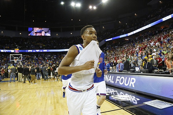 Kansas guard DevonteÕ Graham (4) come off the court after the Jayhawks 78-65 loss in the Jayhawks third-round NCAA Tournament game against Wichita State Sunday, March 22, 2015 at the CenturyLink Center, Omaha, Neb.