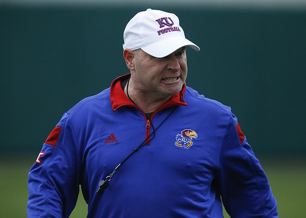 Kansas co-defensive coordinator and cornerbacks coach Kenny Perry grits his teeth as he prepares to give some criticism during spring practice on Tuesday, March 24, 2015.
