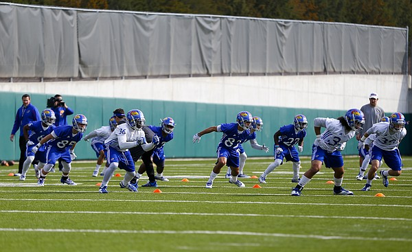 The Jayhawks work on bursting through during spring practice on Tuesday, March 24, 2015.