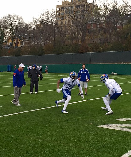 Co-defensive coordinator Kenny Perry works with KU's cornerbacks during a recent practice.