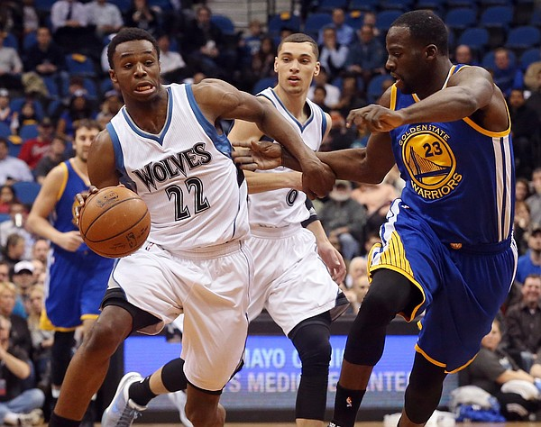 Minnesota Timberwolves' Andrew Wiggins, left, races down court as Golden State Warriors' Draymond Green gives chase in the first quarter of an NBA basketball game, Wednesday, Feb. 11, 2015, in Minneapolis. (AP Photo/Jim Mone)