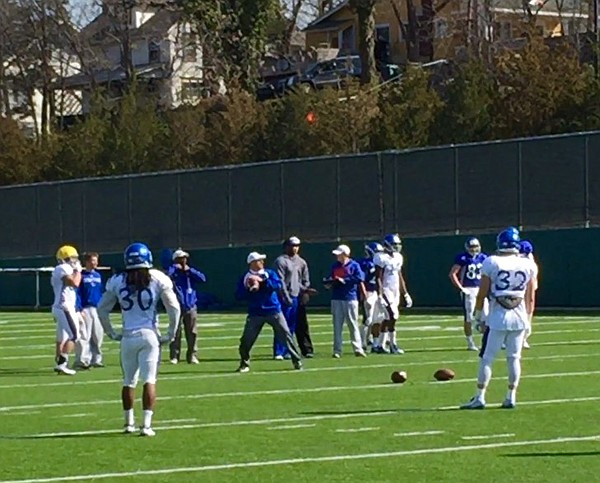 David Beaty, playing quarterback instead of head coach, looks to throw during a drill for KU's cornerbacks at Saturday's practice.