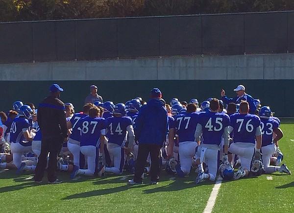 KU coach David Beaty addresses his football team prior to the start of Saturday's spring practice.
