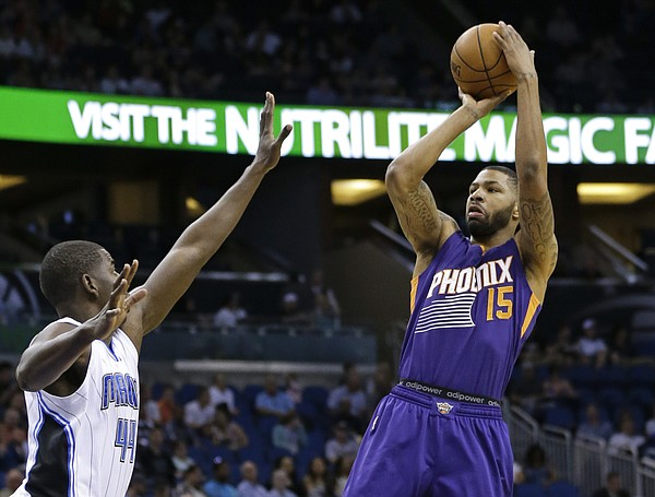 Phoenix Suns' Marcus Morris (15) makes a shot over Orlando Magic's Andrew Nicholson (44) during the first half of an NBA basketball game, Wednesday, March 4, 2015, in Orlando, Fla. (AP Photo/John Raoux)
