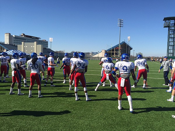 The KU defense dons red pants for Day 4 of spring practices on Tuesday.