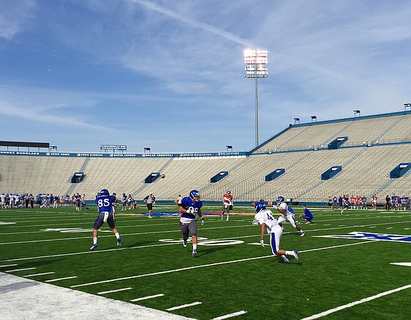 The KU defensive backs and linebackers work on pass break-ups against live offense during Day 5 of the 2015 spring practices on Thursday.