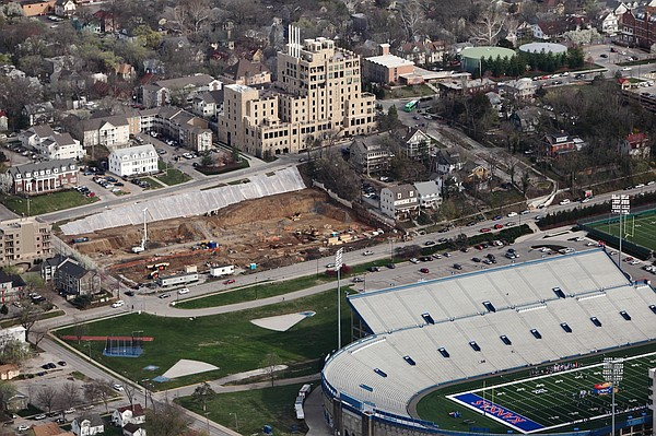 This aerial view taken Thursday, April 2, 2015, shows the construction work being done on a large apartment complex just east of Kansas University's Memorial Stadium. The $75 million complex being built by Chicago-based HERE, LLC will include more than 600 bedrooms.
