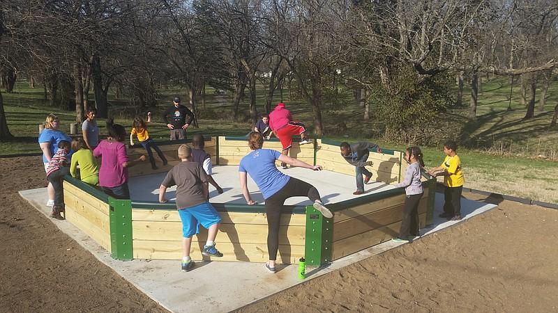 Full Circle Youth and Staff playing GaGa Ball.