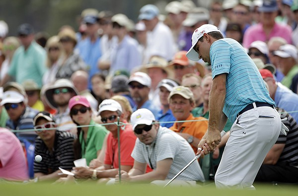 Gary Woodland chips to the 18th hole during the second round of the Masters golf tournament Friday, April 10, 2015, in Augusta, Ga. (AP Photo/Matt Slocum)