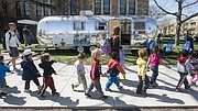 "Preschool students pass by a renovated 1972 Airstream Sovereign Land Yacht on Friday, April 10, 2015 in front of Marvin Hall. The old camper was renovated by Kansas University architecture students and transformed into KU's ""Mobile Collaboratory,"" or moCOLAB. The moCOLAB had its first campus open house that day."