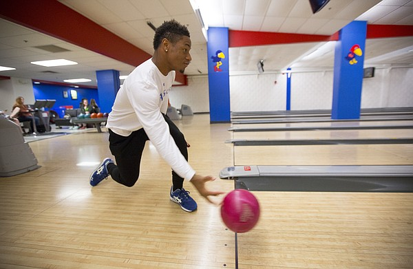 Kansas University freshman Darious Crawley, Houston, Texas, rolls down the lane during a bowling class on Tuesday, April 14, 2015 at Jaybowl. The bowling alley, which has been around since 1953, will close in early May.