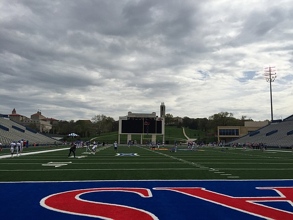 KU receivers coach Klint Kubiak (all black at left) directs the onside kick recovery drill during Friday's practice at Memorial Stadium.