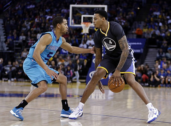Golden State Warriors' Brandon Rush, right, drives the ball against Charlotte Hornets' Kemba Walker during the second half of an NBA basketball game Saturday, Nov. 15, 2014, in Oakland, Calif. The Warriors won 112-87. (AP Photo/Ben Margot)