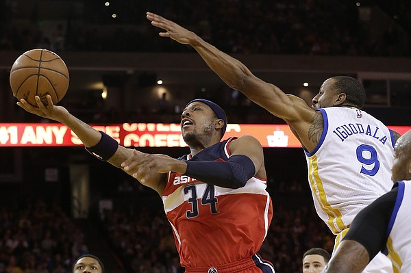 Washington Wizards forward Paul Pierce (34) shoots against Golden State Warriors forward Andre Iguodala (9) during the first half of an NBA basketball game in Oakland, Calif., Monday, March 23, 2015. (AP Photo/Jeff Chiu)