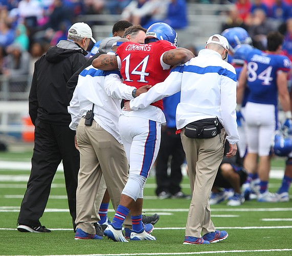Blue Team starting quarterback Michael Cummings his helped off of the field by trainers during the Spring Game on Saturday, April 25, 2015 at Memorial Stadium.