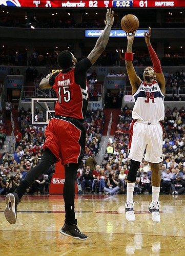 Washington Wizards forward Paul Pierce (34) shoots over Toronto Raptors forward Amir Johnson (15) in the second half of Game 4 in the first round of the NBA basketball playoffs, Sunday, April 26, 2015, in Washington. The Wizards won 125-94 to complete the first sweep of a seven-game series in club history, and advancing them to the second-round. (AP Photo/Alex Brandon)