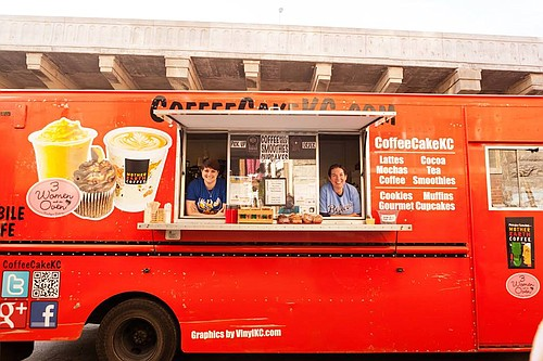 CoffeeCakeKC owners Michelle Ferguson, left, and Kim Niebaum pose inside their Kansas City truck.