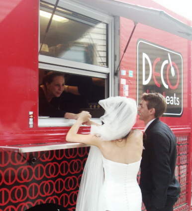A bride and groom line up to sample gourmet street fare from Deco Street Eats, a Kansas City food truck.