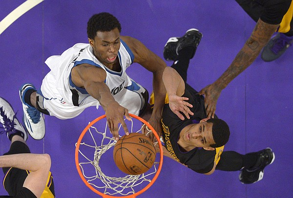 Minnesota Timberwolves forward Andrew Wiggins, left, dunks as Los Angeles Lakers guard Jordan Clarkson defends during the second half of an NBA basketball game, Friday, April 10, 2015, in Los Angeles. The Lakers won 106-98. (AP Photo/Mark J. Terrill)