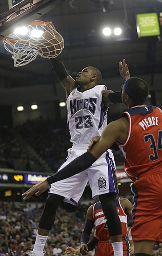 Sacramento Kings guard Ben McLemore, left, stuffs as Washington Wizards forward Paul Pierce, right, looks on during the second half of an NBA basketball game in Sacramento, Calif., Sunday, March 22, 2015. The Kings won 109-86. (AP Photo/Rich Pedroncelli)