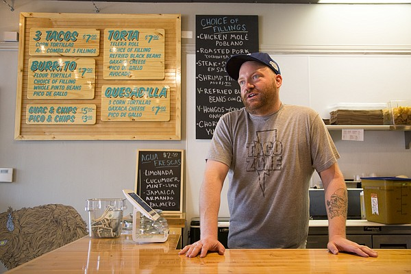 Taco Zone co-owner Brad Shanks talks about the restaurant's first day of business Tuesday.