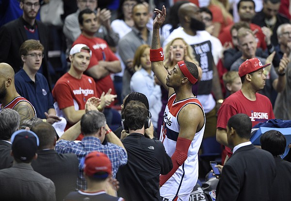 Washington Wizards forward Paul Pierce (34) waves to the crowd as he leaves the court after Game 6 of the second round of the NBA basketball playoffs Atlanta Hawks, Friday, May 15, 2015, in Washington. The Hawks won 94-91. (AP Photo/Nick Wass)