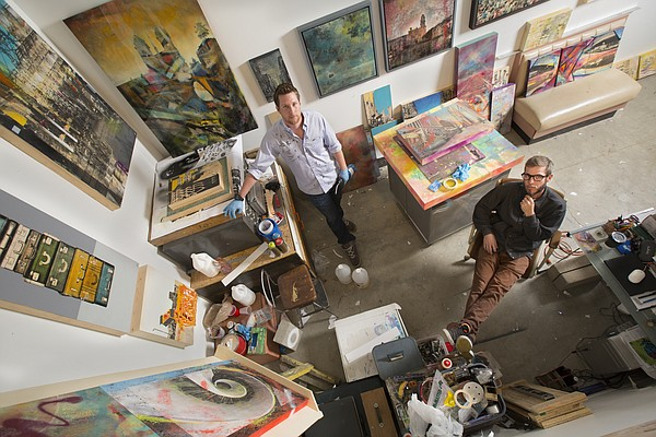 "Lawrence artists John Sebelius, left, and Jeromy Morris are pictured at SeedCo Studios in this Journal-World photo from May 20, 2015. Sebelius and Morris collaborated on a show, ""More Than Meets the Eye,"" in which the two artists have combined their visions on various mixed media pieces that premiered at the Cider Gallery earlier this year."