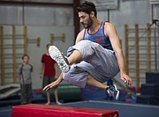 Jason Boyer demonstrates a technique for leaping over vaults during a parkour class held at Lawrence Gymnastics Academy, 4930 Legends Dr. on Sunday, May 17, 2015.