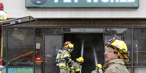 Lawrence firefighters respond to a fire at Pet World, 711 W. 23rd, Monday, May 25, 2015.