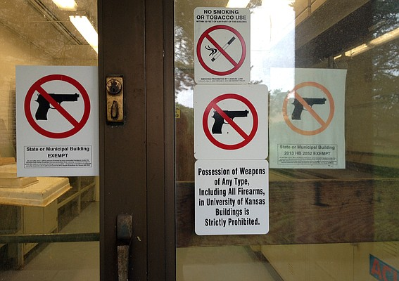 No guns signs are posted on a side door of KU's Art and Design Building, as well as other buildings on campus.