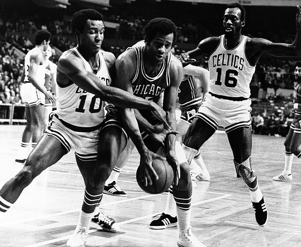 Chet Walker of the Chicago Bulls is guarded by Jo Jo White of the Boston Celtics (10), as he tried to lay up a shot in their game in Boston at night on Jan. 13, 1972. Tom Sanders of Celtics Comes in at right. Boston won the game 113-112. (AP Photo)