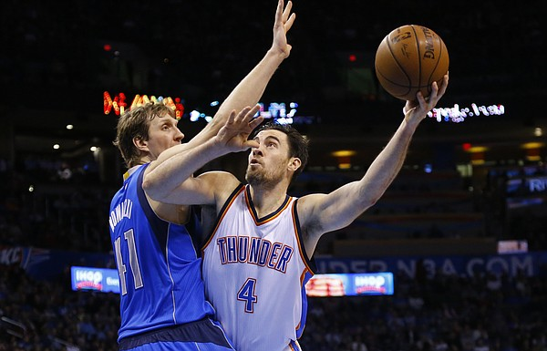 Oklahoma City Thunder forward Nick Collison (4) shoots in front of Dallas Mavericks forward Dirk Nowitzki (41) during an NBA basketball game between the Dallas Mavericks and the Oklahoma City Thunder in Oklahoma City, Friday, Feb. 20, 2015. Oklahoma City won 104-89. (AP Photo/Sue Ogrocki)