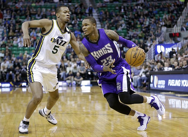 Sacramento Kings guard Ben McLemore (23) drives against Utah Jazz guard Rodney Hood (5) during the first quarter of an NBA basketball game Wednesday, April 8, 2015, in Salt Lake City. (AP Photo/Rick Bowmer)