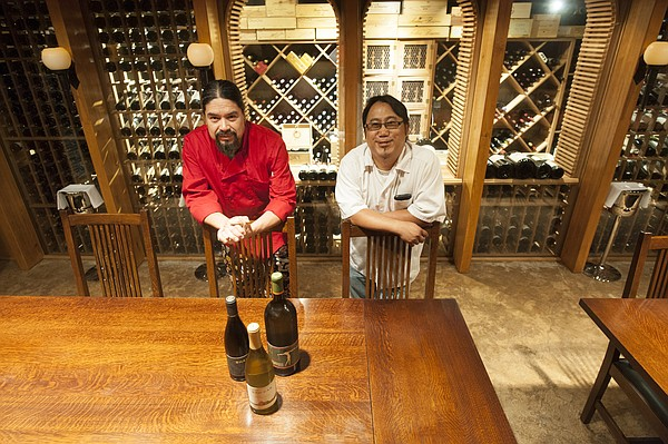 From left, chefs/restauranteurs Alejandro Lule and Subarna Bhattachan are two of the five Lawrence food veterans involved in Two Tables, a new reservations-only restaurant located in the wine cellar underneath La Parrilla, 724 Massachusetts St.