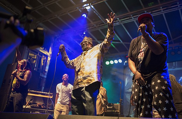 Legendary funk artist George Clinton raises up the crowd as he performs with P-Funk as part of the Free State Festival, Wednesday, June 24, 2015 outside the Lawrence Arts Center.