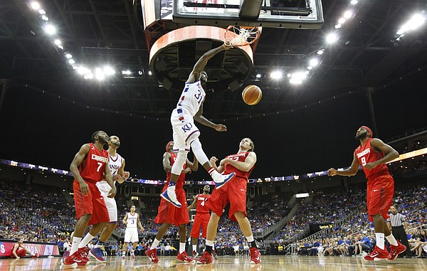 Kansas forward Jamari Traylor (31) delivers a tomahawk dunk over members of Team Canada during the third quarter of Friday's World University Games exhibition at Sprint Center.