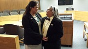 Mattisa (left) and Darla Harrison are pictured at their marriage ceremony March 25, 2015, at the Douglas County Courthouse. They believe they are the first American Indian couple to legally wed here. Darla is Lakota Sioux and Cheyenne and Arapaho, and Mattisa is Navajo.