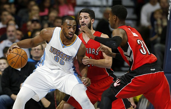 Denver Nuggets forward Darrell Arthur, left, is stopped as he tries to drive to the basket for a shot by Toronto Raptors guards Greivis Vasquez, center, of Venezuela, and Terrence Ross in the first quarter of an NBA basketball game Sunday, Dec. 28, 2014, in Denver. (AP Photo/David Zalubowski)