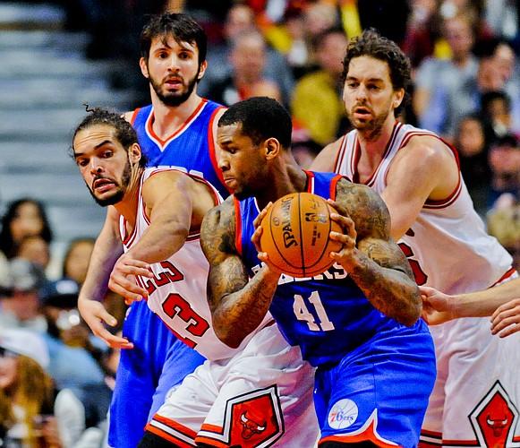 Chicago Bulls center Joakim Noah (13) against Philadelphia 76ers forward Thomas Robinson (41) during an NBA basketball game Saturday, April 11, 2015, in Chicago. (AP Photo/Matt Marton)