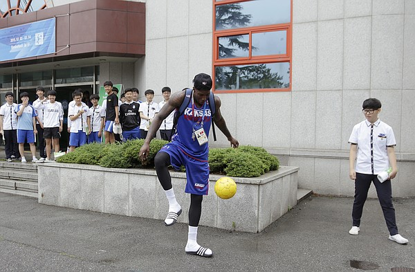 Jamari Traylor tries out his soccer skills with Gwangju High School students before a Team USA practice at the school Wed., July 1. Team USA will play an exhibition game against China on Thursday, July 2.