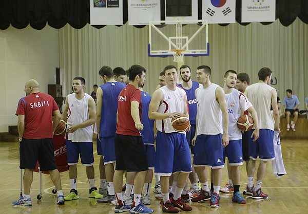 Members of the Serbian team break from a huddle at the end of their practice before Team USA took the court for a practice at Gwangju High School Wed., July 1. Team USA will play an exhibition game against China on Thursday, July 2 and will play Serbia in tournament pool play Wed., July 8.