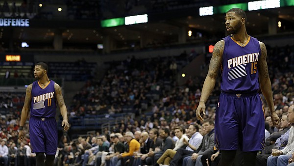 Phoenix Suns' Marcus Morris and Markieff Morris look to the bench during an NBA basketball game against the Milwaukee Bucks Tuesday, Jan. 6, 2015, in Milwaukee. (AP Photo/Aaron Gash)