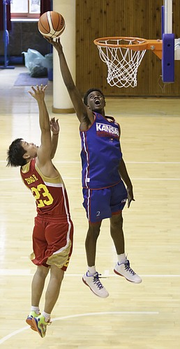 Kansas guard Lagerald Vick, right, leaps for a block in a Team USA 93-56 scrimmage game win over China Thursday, July 2.