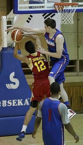 Kansas center Hunter Mickelson blocks a shot in a Team USA 93-56 scrimmage game win over China Thursday, July 2.