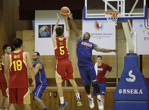 Kansas guard Wayne Selden Jr. jumps to block a shot in a Team USA 93-56 scrimmage game win over China Thursday, July 2.