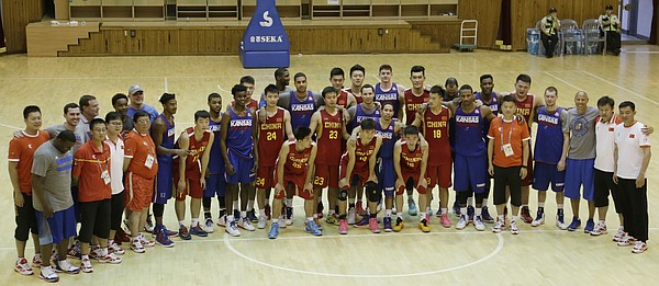 Team USA and China take a group photograph together after a Team USA 93-56 scrimmage game win over China Thursday, July 2.