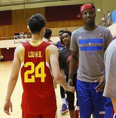 Kansas forward Carlton Bragg shakes hands with Team China players after a Team USA 93-56 win in a scrimmage game Thursday, July 2. Bragg who has a broken nose, sat out the scrimmage.